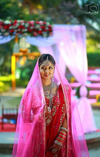Double dupatta draping style with light one on head