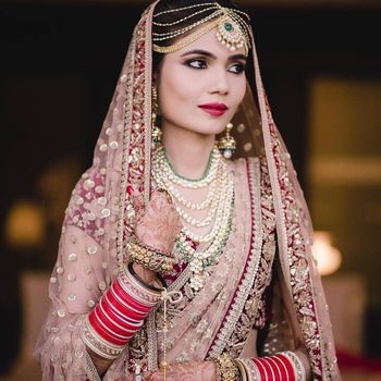 Offbeat bridal lehenga in light pink and marsala