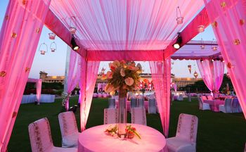 table centerpieces tall with pink drapes all around