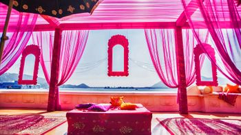 mehendi raani pink theme with frames and drapes overlooking sea