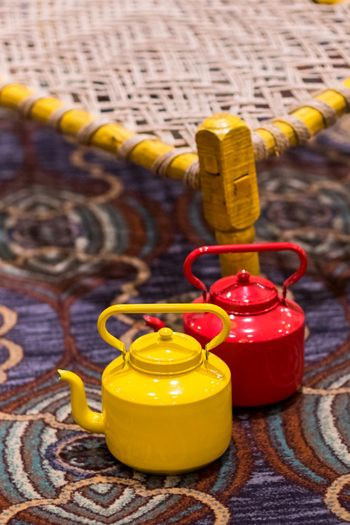 Red and yellow tea kettles in decor