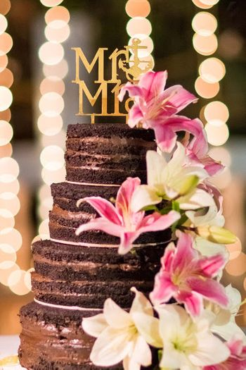 Chocolate wedding cake with florals and mr and mrs topper