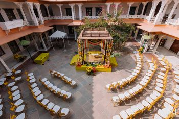 pretty intimate wedding decor mandap with seating
