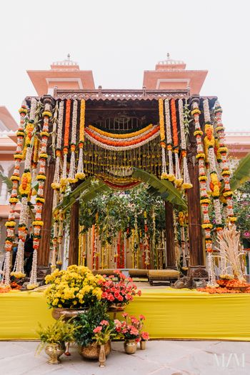 pretty south indian mandap decor idea with lots of floral strings