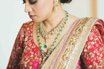 Layered bridal necklace with green beads with red lehenga