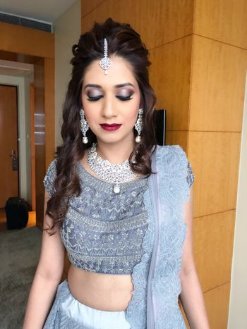 Pretty bride in silver lehenga with diamond jewellery