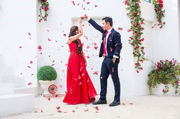 Couple Dancing Pre Wedding Shot with Rose Petal Shower