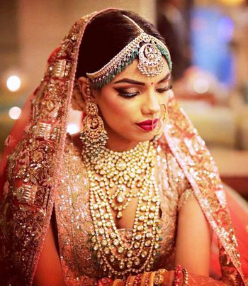 Layered bridal jewellery and mathapatti