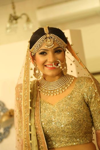 Photo of Gold Bride Portrait with Gold Bridal Jewelry