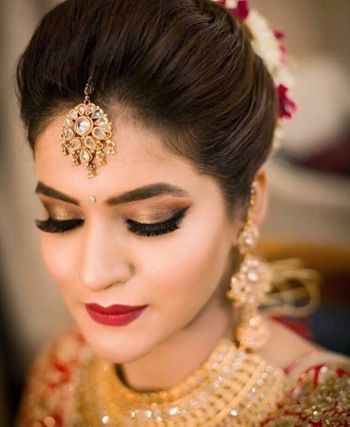 Brown smokey eyes and red lips for the bride