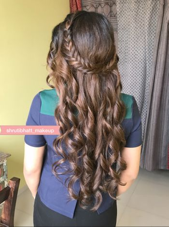 Photo of Open hairstyle with braided band and waves for engagement