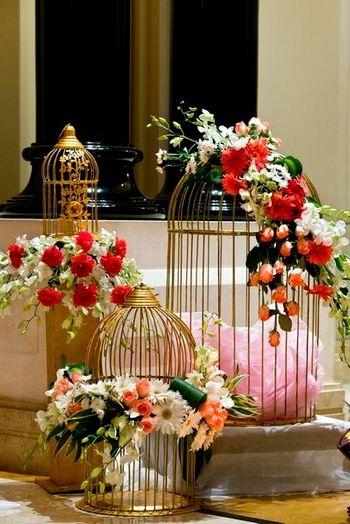 Birdcages with floral arrangements