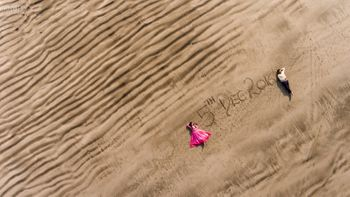 Save the date idea on sand with drone photography