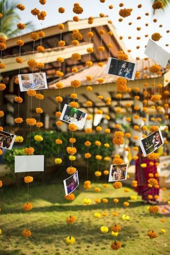 Hanging floral strings with photographs.