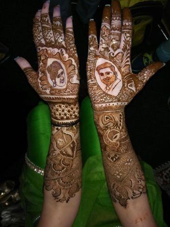 Unique mehendi design with bride and groom caricatures