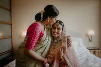 A candid shot of the bride and her mother
