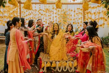 A fun bride and bridesmaid shot at Haldi ceremony!