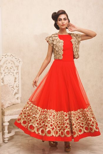 Photo of red gown with crop gold jacket