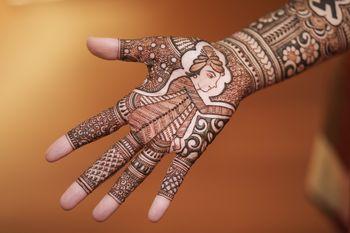 Hand mehndi with intricate design.