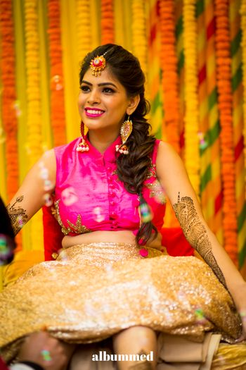 A bride all happy and smiley at her mehendi ceremony