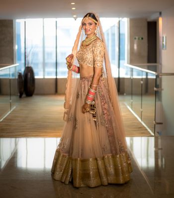Simple peach tulle lehenga with matching dupatta and heavy blouse