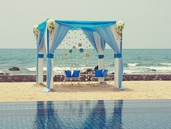 Photo of Beach Side Blue Mandap Decor