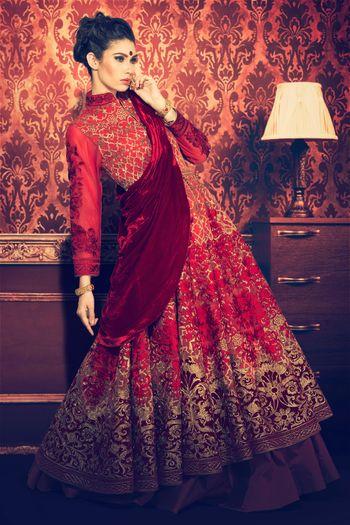 Red and maroon bridal lehenga with full sleeved blouse
