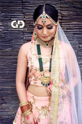 Contrasting jewellery with pastel lehenga and smokey eyes