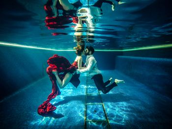 Couple underwater kissing shot