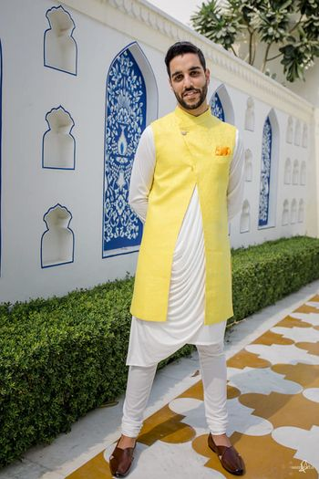 Groom wearing a cowled kurta with a front slit bandhgala.