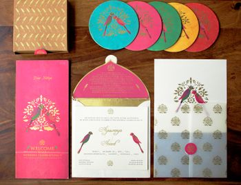 Photo of peacock themed invitation cards