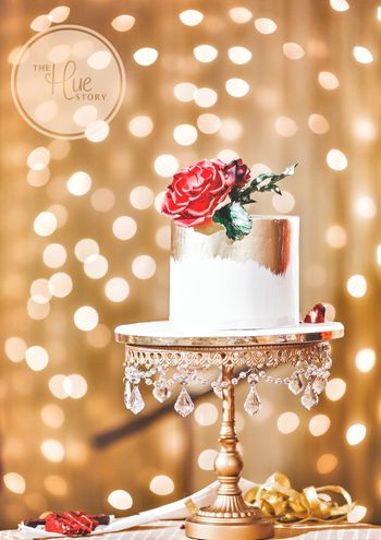 Simple floral cake with gold foil on unique stand