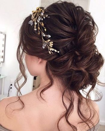 Messy bun with embellished pin for engagement
