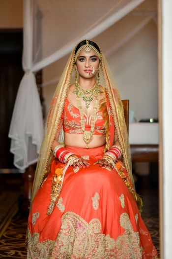 Bright orange and gold bridal lehenga