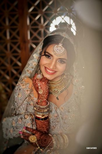 Photo of Happy bride wearing offbeat bridal lehenga
