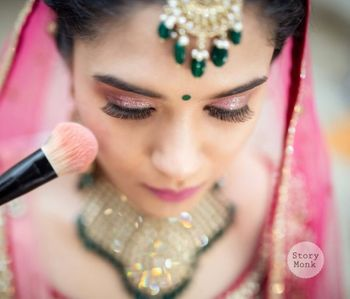 light pink smokey eye makeup with pink lehenga