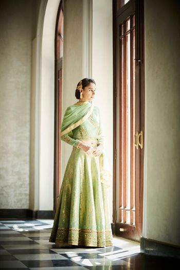 Photo of Light green and gold lehenga for mehendi
