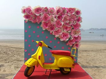 Beach wedding photobooth with scooter