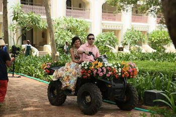 Photo of bride groom small tractor