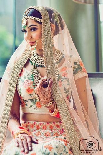 Offbeat bride portrait in floral lehenga