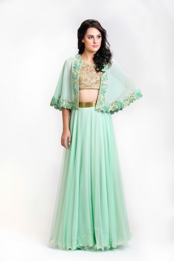 Photo of mint and gold cape top with lehenga skirt