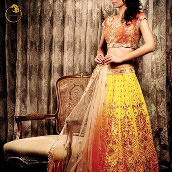 Photo of yellow and orange bright sangeet lehenga with short sleeves