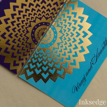 Photo of Blue wedding card with gold foil print