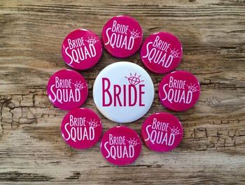 Bachelorette party badges saying girl squad