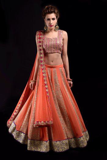 light orange net layered lehenga with sleeveless blouse