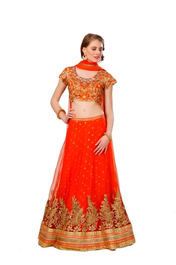 orange net layered lehenga with gold border