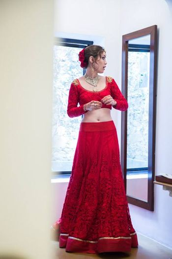 red threadwork bridal lehenga with detailing