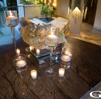 Photo of Candle lit table centerpiece with flowers