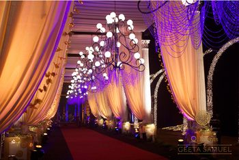 Gold and Purple Drapes with Chandeliers Entrance Decor