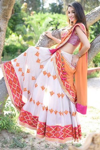 Photo of light batik print lehengas with bandhani chunni for mehendi